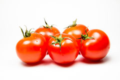Fresh red tomatoes isolated on white background Royalty Free Stock Images