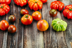 Fresh red tomatoes on an old wooden table Royalty Free Stock Photography