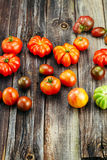 Fresh red tomatoes on an old wooden table Royalty Free Stock Images