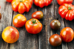 Fresh red tomatoes on an old wooden table Royalty Free Stock Image