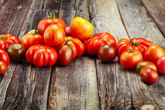 Fresh red tomatoes on an old wooden table Stock Images