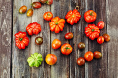Fresh red tomatoes on an old wooden table Royalty Free Stock Photos
