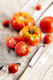Fresh red tomatoes  on an old wooden tabletop Stock Photography