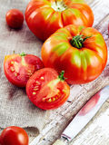 Fresh red tomatoes on an old wooden tabletop Stock Photos