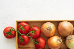 Fresh Red Tomatoes and Onions, Wooden Container, White Background stock images