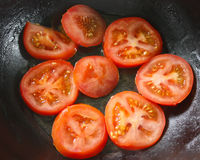 Fresh red tomatoes on the pan Royalty Free Stock Photos