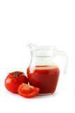 Fresh red tomatoes and tomato juice in jug isolated on a white Royalty Free Stock Photography