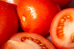 Fresh red tomatoes with water drops. Royalty Free Stock Photography