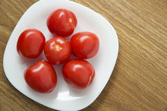 Fresh red tomatoes in white plate Royalty Free Stock Photos