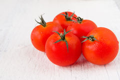Fresh red tomatoes on white wooden table Royalty Free Stock Photo