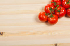 Fresh red tomatoes on the wood table, isolated Royalty Free Stock Image