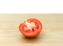 Fresh red tomatoes on wooden background. The fresh red tomatoes on wooden background Royalty Free Stock Photography