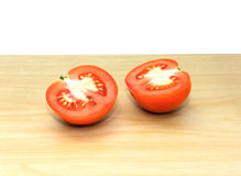 Fresh red tomatoes on wooden background. Red tomatoes on wooden background Stock Photos