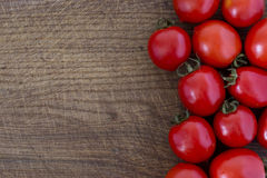 Fresh red tomatoes. On a wooden table Stock Images