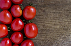 Fresh red tomatoes. On a wooden table Stock Image