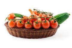 Fresh red tomatos,  cucumber and onions isolated on white in the Stock Photo