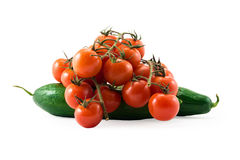 Fresh red tomatos with green brunch and cucumber isolated on whi Stock Image