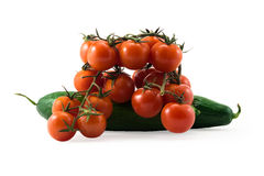 Fresh red tomatos with green brunch and cucumber Royalty Free Stock Photos