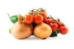 Fresh red tomatos with green brunch ,  cucumber and onions isola Stock Photography