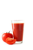 Fresh red tomatos and tomato juice in glass isolated on a white Stock Image