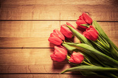 Fresh red tulip flowers bouquet on wood. Vintage Stock Photos
