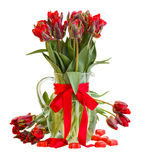 Fresh  red tulip flowers in vase with hearts Stock Photo
