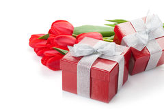 Fresh red tulips with gift boxes Royalty Free Stock Images