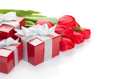 Fresh red tulips with gift boxes Royalty Free Stock Photography