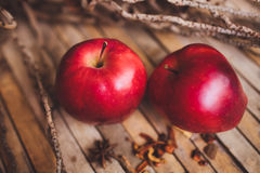 Fresh red two couple apple on brown rustic board royalty free stock image