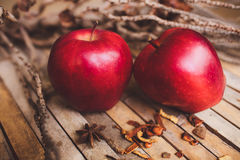 Fresh red two couple apple on brown rustic board Stock Photos