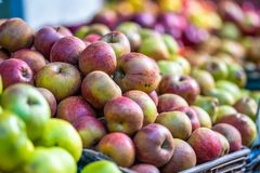 Fresh Red and Various Apples. In a Market with Close Up Bokeh Background royalty free stock image