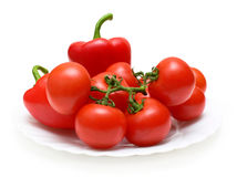 Fresh red vegetables on plate Royalty Free Stock Photos