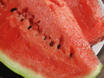 Fresh red watermelon slices on the plate. Close-up red watermelon slices on the white plate royalty free stock photo