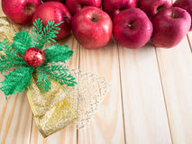 Fresh red wet apples with ribbon chrismas Royalty Free Stock Photo
