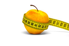 Fresh red-yellow apple with measuring tape Royalty Free Stock Images