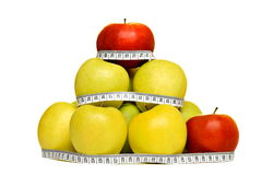 Fresh red and yellow apples with measuring tape Royalty Free Stock Image