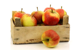 Fresh red and yellow apples in a wooden box Stock Photos