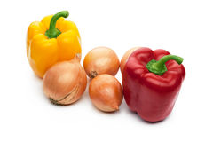 Fresh red and yellow bell peppers and onions Stock Photo