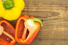 Fresh red and yellow bell peppers Stock Images
