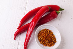 Fresh red and yellow chili peppers with spice Royalty Free Stock Image