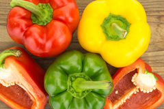 Fresh red,  yellow and green bell peppers Royalty Free Stock Images