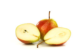 A fresh red and yellow pear and two halves Stock Images