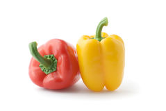 Fresh red and yellow peppers close-up. Isolated over white Stock Image