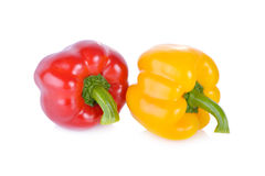 Fresh red and yellow sweet pepper with stem on white background Stock Image