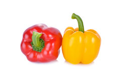 Fresh red and yellow sweet pepper with stem on white background Stock Photos
