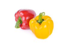 Fresh red and yellow sweet pepper with stem on white background Royalty Free Stock Photo