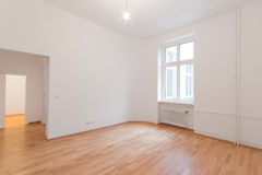 Fresh renovated room with wooden oak floor, white walls and wind. Fresh renovated flat - home / apartment - fresh renovated room with wooden oak floor, white Royalty Free Stock Photos
