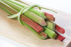 Fresh rhubarb. On wooden board Stock Photo