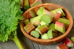 Fresh rhubarb in brown bowl Stock Images