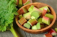 Fresh rhubarb in brown bowl Stock Images